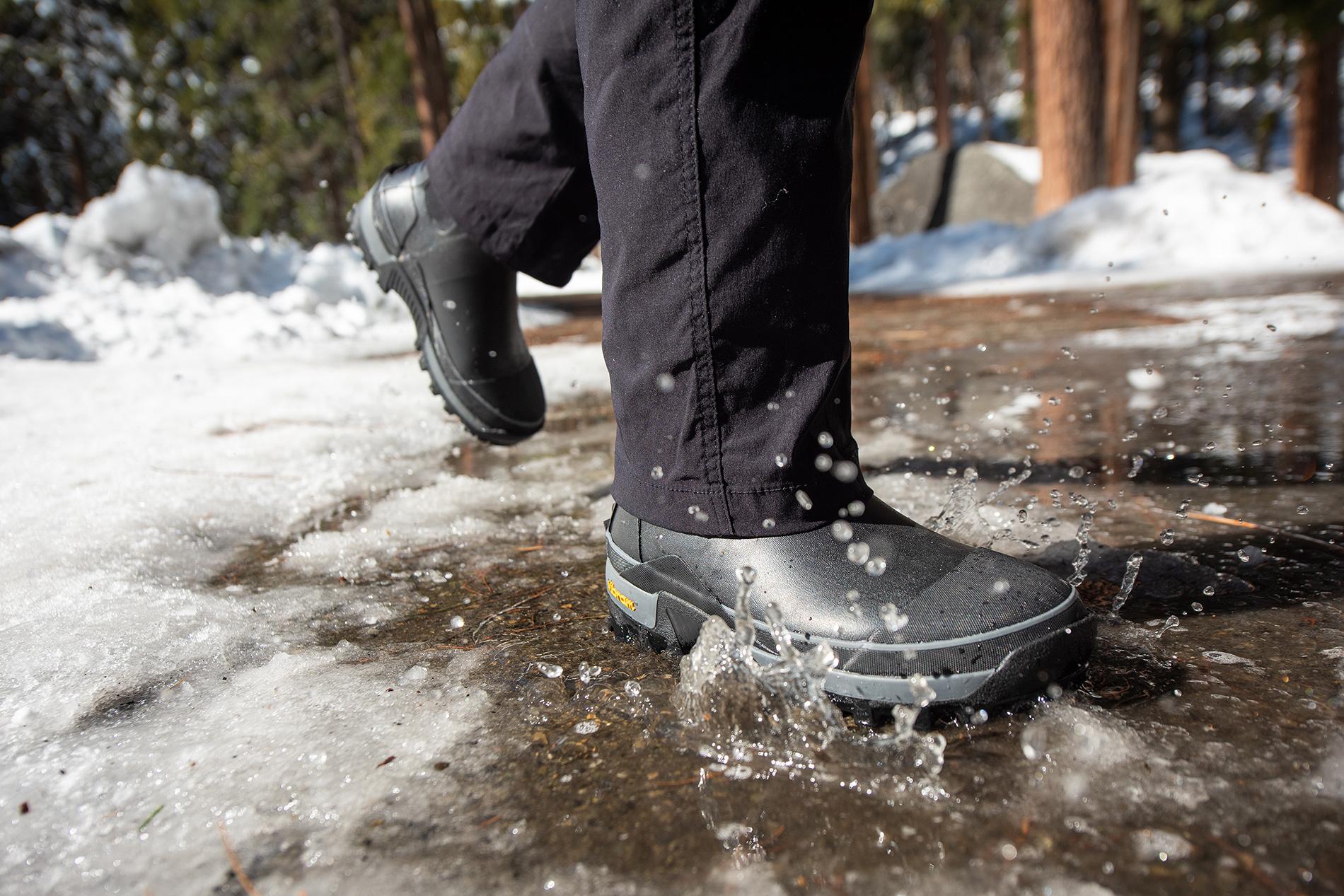 Men's winter boots in snowy scene