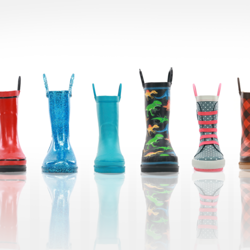 Line of kids rain boots on white background
