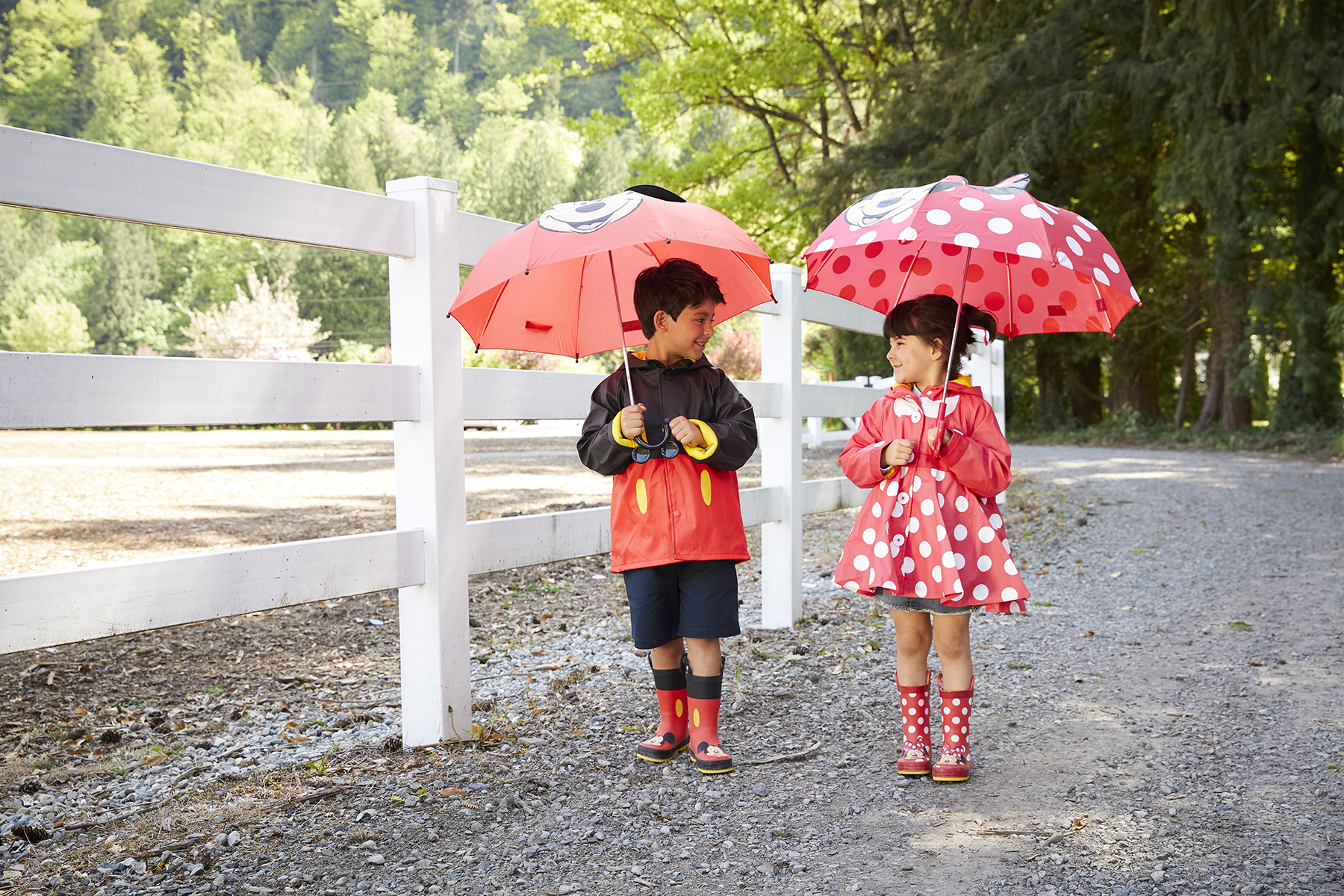 Kids wearing Mickey Mouse and Minnie Mouse rain gear
