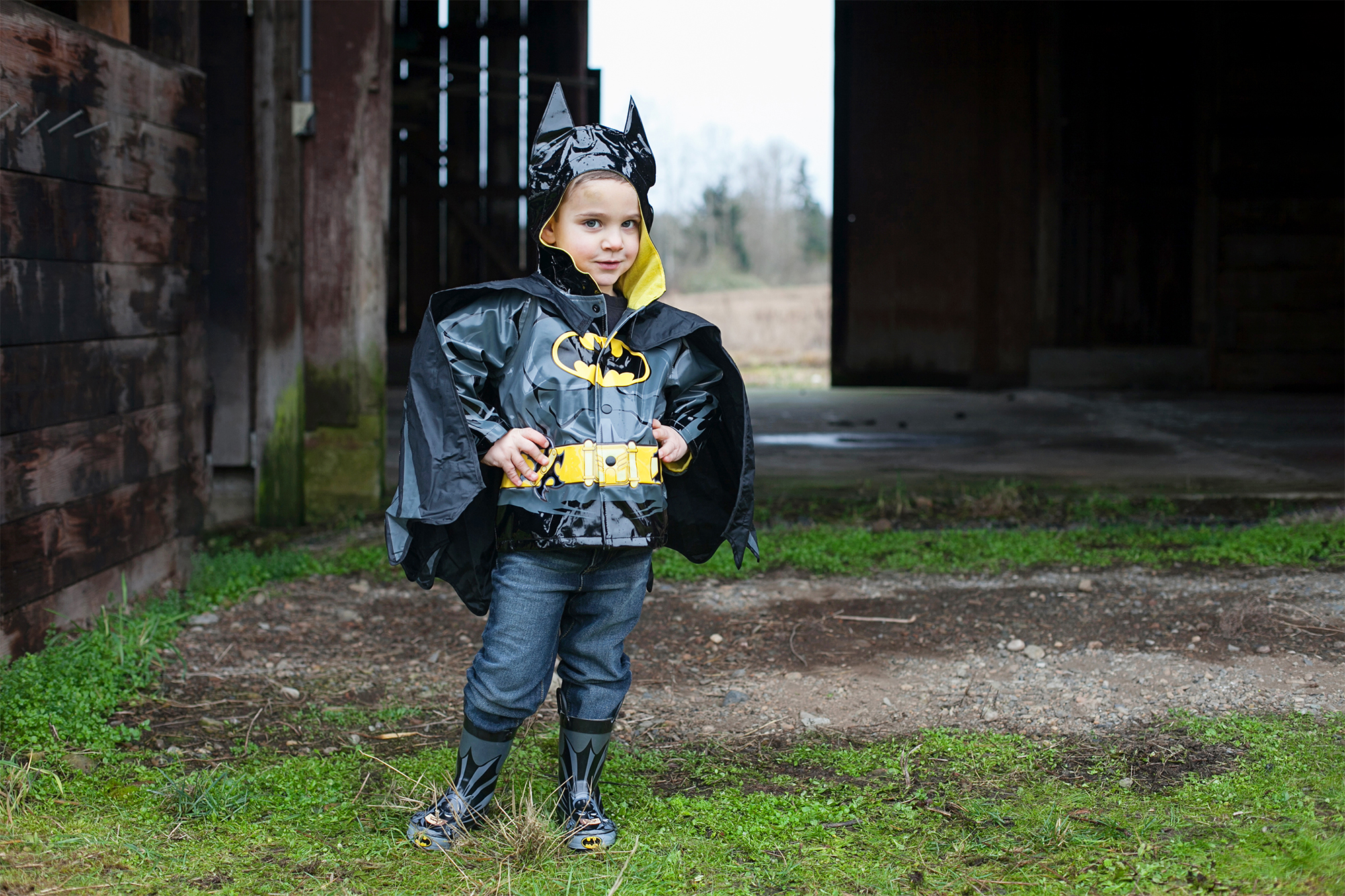Kid posing in Batman rain gear set
